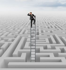 28604973 - businessman looking for the solution of the maze